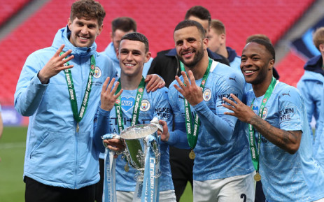 Man City outclass Tottenham to retain League Cup in front of 8,000 fans